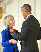 United States President Barack Obama presents the 2015 National Humanities Medal to Elaine Pagels, Historian & Author of Princeton, New Jersey, during a ceremony in the East Room of the White House in Washington, DC on Thursday, September 22, 2016.<br /> Credit: Ron Sachs / CNP