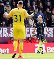 Manchester City's Ederson implores Manchester City's Oleksandr Zinchenko to calm down<br /> <br /> Photographer Rich Linley/CameraSport<br /> <br /> The Premier League - Burnley v Manchester City - Sunday 28th April 2019 - Turf Moor - Burnley<br /> <br /> World Copyright © 2019 CameraSport. All rights reserved. 43 Linden Ave. Countesthorpe. Leicester. England. LE8 5PG - Tel: +44 (0) 116 277 4147 - admin@camerasport.com - www.camerasport.com