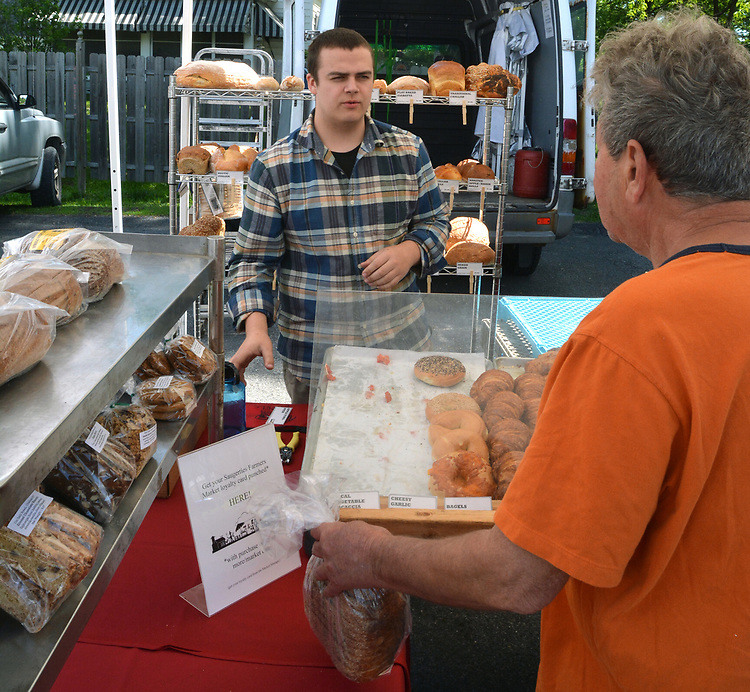 A customer visiting one of the booths at the Opening Day of the 2017 Saugerties Farmer's Market on Saturday, May 27, 2017. Photo by Jim Peppler. Copyright/Jim Peppler-2017.