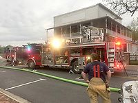 Graham Thomas/Siloam Sunday<br /> Siloam Springs Fire and Police Departments responded to a fire at 201 W. University St. in downtown Siloam Springs on Thursday morning. The fire was located in the laundry area on the second floor of the Park House restaurant.