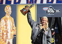Nov 14, 2010; Pomona, CA, USA; NHRA nostalgia funny car driver Leah Pruett-Leduc holds her 2010 nostalgia funny car championship trophy during the Auto Club Finals at Auto Club Raceway at Pomona. Mandatory Credit: Mark J. Rebilas-