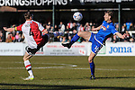 Mark Ricketts of Woking and Craig Clay of Grimsby Town battle for the ball during the Vanamara Conference League match between Woking and Grimsby Town at the Kingfield Stadium, Woking, Surrey<br /> Picture by David Horn/eXtreme aperture photography +44 7545 970036<br /> 07/03/2015