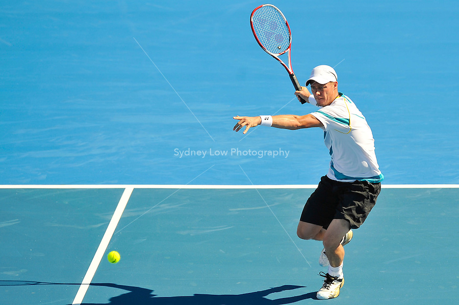MELBOURNE, 14 JANUARY - Lleyton Hewitt (AUS) hits a forehand in a match against Nikolay Davydenko (RUS) on day three of the 2011 AAMI Classic at Kooyong Tennis Club in Melbourne, Australia. (Photo Sydney Low / syd-low.com)