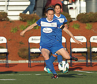 Boston Breakers forward Katie Schoepfer (12) passes the ball.  In a National Women's Soccer League Elite (NWSL) match, the Boston Breakers (blue) defeated Chicago Red Stars (white), 4-1, at Dilboy Stadium on May 4, 2013.