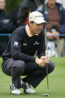 Padraig Harrington lines up his putt on the 4th hole during the 3rd round of the BMW PGA Championship at Wentworth Club, Surrey, England 26th may 2007 (Photo by Eoin Clarke/NEWSFILE)