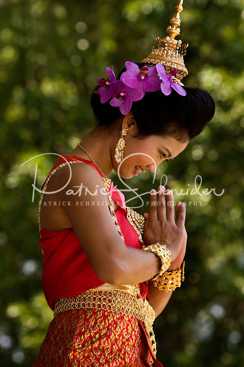 A young woman in traditional attire dances during the Charlotte Dragonboat Association racing on Lake Norman in NC.