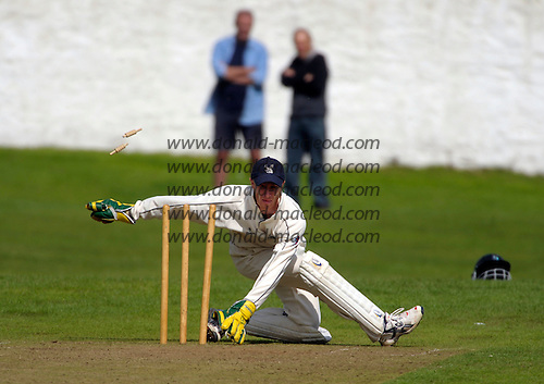 Carlton CC V Grange CC, Scottish National Cricket League, Premier Division, at Grange Loan, Edinburgh - Grange stand-in wicket-keeper Gregor Maiden makes a flamboynt attempt at a stumping, without success - Picture by Donald MacLeod 25.07.09