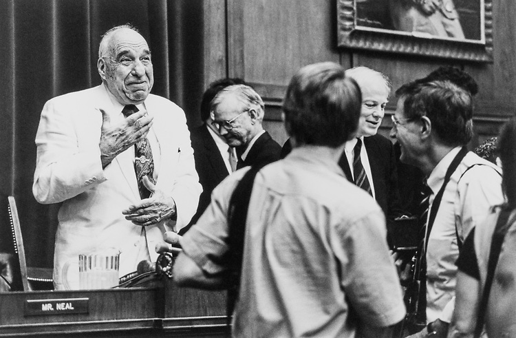 Rep. Henry B. Gonzalez, D-Tex. jokes with photographers after the first day of House Banking hearing on Whitewater on July 28, 1994. (Photo by Laura Patterson/CQ Roll Call)