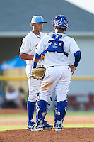 Burlington Royals catcher Meibrys Viloria (29) has a chat on the mound with relief pitcher Enmanuel Camacho (9) during the game against the Greeneville Astros at Burlington Athletic Park on June 29, 2014 in Burlington, North Carolina.  The Royals defeated the Astros 11-0. (Brian Westerholt/Four Seam Images)