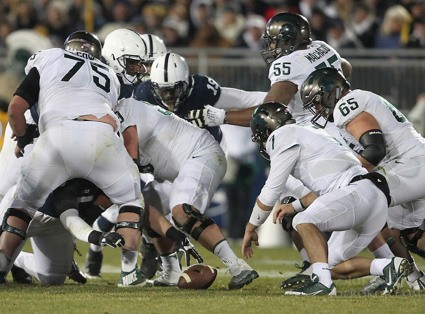 State College, PA - 11/26/2016:  Michigan State QB Tyler O'Connor fumbles the ball. Penn State would recover the fumble. #7 Penn State defeated Michigan State by a score of 45-12 to secure the Big Ten conference East Division championship on Senior Day, Saturday, November 26, 2016, at Beaver Stadium in State College, PA.<br /> <br /> Photos by Joe Rokita / JoeRokita.com