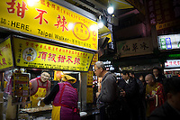 Residents queue for snacks at Hua Xi Street night market in Wanhua District, Taipei, Taiwan, 2015.