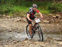 NWA Democrat-Gazette/ANDY SHUPE<br /> David Green of Keithville, La., rides across Lee Creek Saturday, Sept. 19, 2015, during the Northwest Arkansas Mountain Bike Championships at Devil's Den State park.