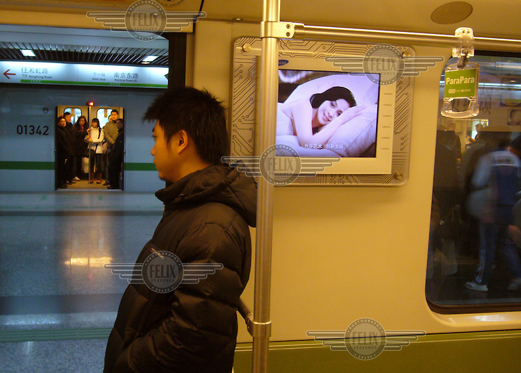 Passenger on a Shanghai underground train.