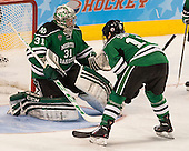 Zane Gothberg (North Dakota - 31), Dillon Simpson (North Dakota - 18) - The University of Minnesota Golden Gophers defeated the University of North Dakota 2-1 on Thursday, April 10, 2014, at the Wells Fargo Center in Philadelphia to advance to the Frozen Four final.