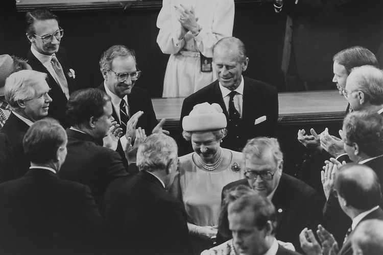 Queen Elizabeth II, Prince Philip, Duke of Edinburgh, are greeted by Rep. Benjamin A. Gilman, R-N.Y., as they appear to onlookers, including Sen. George Mitchell, D-Maine, Sen. Thad Cochran, R-Miss., Sen. Don Nickles, R-Okla., and Sen. Bob Kasten, R-Wis., on May 20, 1991. (Photo by Laura Patterson/CQ Roll Call via Getty Images)