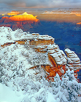 Havey snow and alpen glow at Mather Point, Grand Cansyon National Park, Arizona, South Rim, Colorado River below