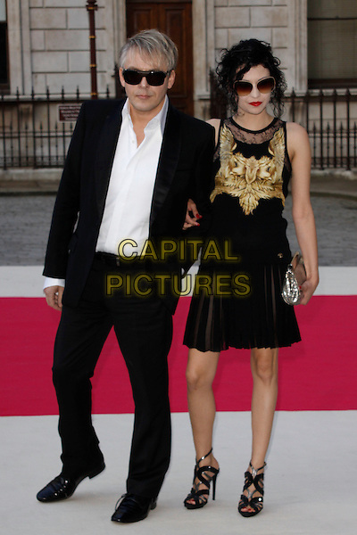 Nick Rhodes & guest.Arrivals at the Royal Academy Summer Exhibition 2012 - preview party held at the Royal Academy of Arts, London, England..May 30th, 2012.full length black dress suit white shirt sunglasses shades .CAP/AH.©Adam Houghton/Capital Pictures.
