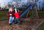 A Grandmother with her Grandson having fun on an outdoor playground