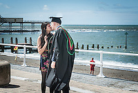 Aberystwyth, Ceredigion, West Wales Tuesday 13 July 2016 UK Weather: Newly graduated students from the city's university take advantage of the break in the weather, despite the strong wind to have their photos taken on the promenade