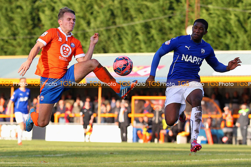 Chez Isaac of Braintree Town tangles with Tendayi Darikwa of Chesterfield - Braintree Town vs Chesterfield - FA Challenge Cup 1st Round Football at the Cressing Road Stadium, Braintree, Essex - 09/11/14 - MANDATORY CREDIT: Gavin Ellis/TGSPHOTO - Self billing applies where appropriate - contact@tgsphoto.co.uk - NO UNPAID USE
