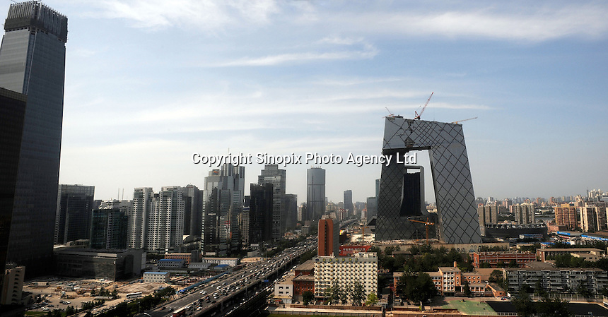The new CCTV nears completion and towers over the Beijing skyline as seen in the Central business district of Beijing..03 Jul 2008