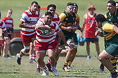 Iafeta Luamanu brings the ball back infield as he tries to avoid Petelo Sili. Counties Manukau Premier Counties Power Club Rugby game between Karaka and Pukekohe, played at the Karaka Sports Park on Saturday March 10th 2018. Pukekohe won the game 31 - 27 after trailing 5 - 20 at halftime.<br /> Photo by Richard Spranger.