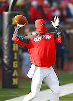 Prepared for the cold, Ohio State Buckeyes quarterback Braxton Miller (5) warms up for the Wolverines at Michigan Stadium in Ann Arbor, MI on November 30, 2013.  (Chris Russell/Dispatch Photo)