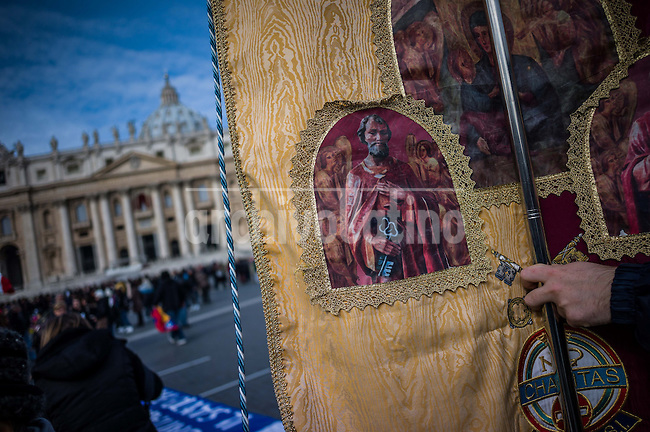 People on S.Peter Square in the Vatican attends Pope Francis  his first Angelus on Sunday , March 17 2013