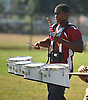 Aaron Dawson of Clarke High School practices with the marching band on the school's football field on Friday, September 18, 2015. The senior excels as both a drummer and a running back on the gridiron.<br /> <br /> James Escher