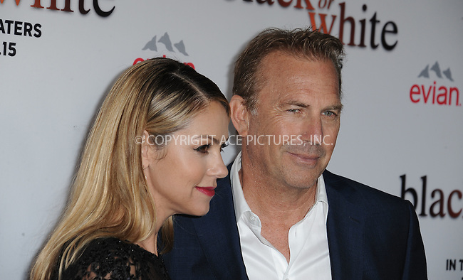WWW.ACEPIXS.COM<br /> <br /> January 20 2015, LA<br /> <br /> Kevin Costner and Christine Baumgartner arriving at the premiere of Relativity Media's 'Black or White' at Regal Cinemas L.A. Live on January 20, 2015 in Los Angeles, California.<br /> <br /> By Line: Peter West/ACE Pictures<br /> <br /> <br /> ACE Pictures, Inc.<br /> tel: 646 769 0430<br /> Email: info@acepixs.com<br /> www.acepixs.com