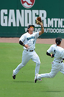 Jupiter Hammerheads outfielder Alex Burg (29) catches a fly ball during a game against the Tampa Yankees on July 18, 2013 at Roger Dean Stadium in Jupiter, Florida.  Jupiter defeated Tampa 6-1.  (Mike Janes/Four Seam Images)