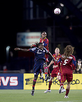 New England Revolution midfielder Shalrie Joseph (21) and Real Salt Lake defender Jamison Olave (4) battle for head ball. Real Salt Lake defeated the New England Revolution, 2-1, at Gillette Stadium on October 2, 2010.