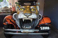 Tiger car at Haw Par Villa - a one-of-a-kind theme park in Singapore with over a thousand statues and a hundred dioramas depicting scenes from Chinese mythology,  Confucian stories, folklore and legends.  Originally called Tiger Balm Gardens, the park was built by the Burmese-Chinese brothers Aw Boon Haw and Aw Boon Par  who were the developers of Tiger Balm ointment. They created the park in 1937 for teaching the public traditional Chinese values. The most renowned attraction at Haw Par Villa is the Ten Courts of Hell featuring gruesome depictions of hell in  Buddhism and Chinese mythology.