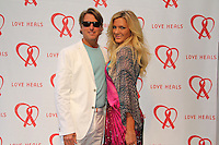 Mark and Kelli Kot attend The Let's Misbehave Party to Benefit Love Heals on July 19, 2014 (Photo By Taylor Donohue/Guest Of A Guest)