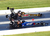 Jun 3, 2018; Joliet, IL, USA; NHRA top fuel driver Leah Pritchett (far) defeats Blake Alexander during the Route 66 Nationals at Route 66 Raceway. Mandatory Credit: Mark J. Rebilas-USA TODAY Sports