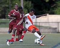 Syracuse University forward Chris Nanco (17)attempts to control the ball as Boston College midfielder/defender Atobra Ampadu (6) pressures.Boston College (maroon) defeated Syracuse University (white/orange), 3-2, at Newton Campus Field, on October 8, 2013.