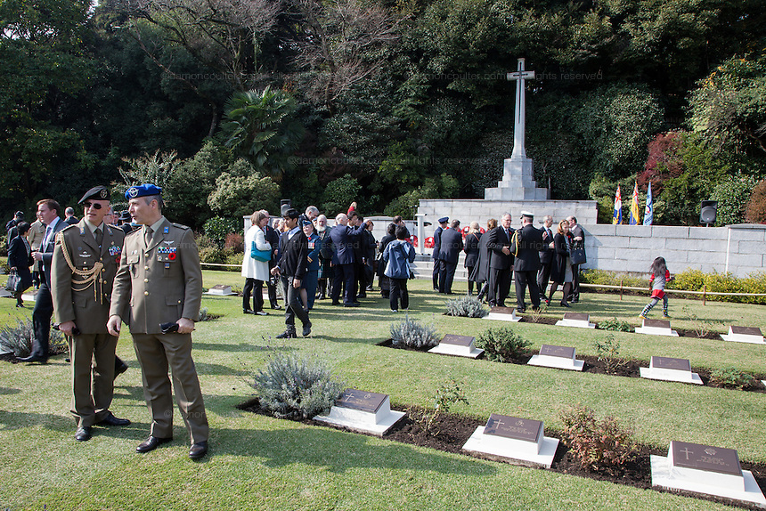 Military personnel and dignitaries after a Remembrance Day ceremony at the Yokohama War Cemetery, Hodogaya. Yokohama, Japan. Sunday November 9th 2014