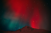 Red aurora at Hatcher Pass in the Matanuska Valley. Winter in Southcentral Alaska.