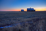 Washington, Eastern. Barns on a farm South of Ritzville in the last light of a autumn day.