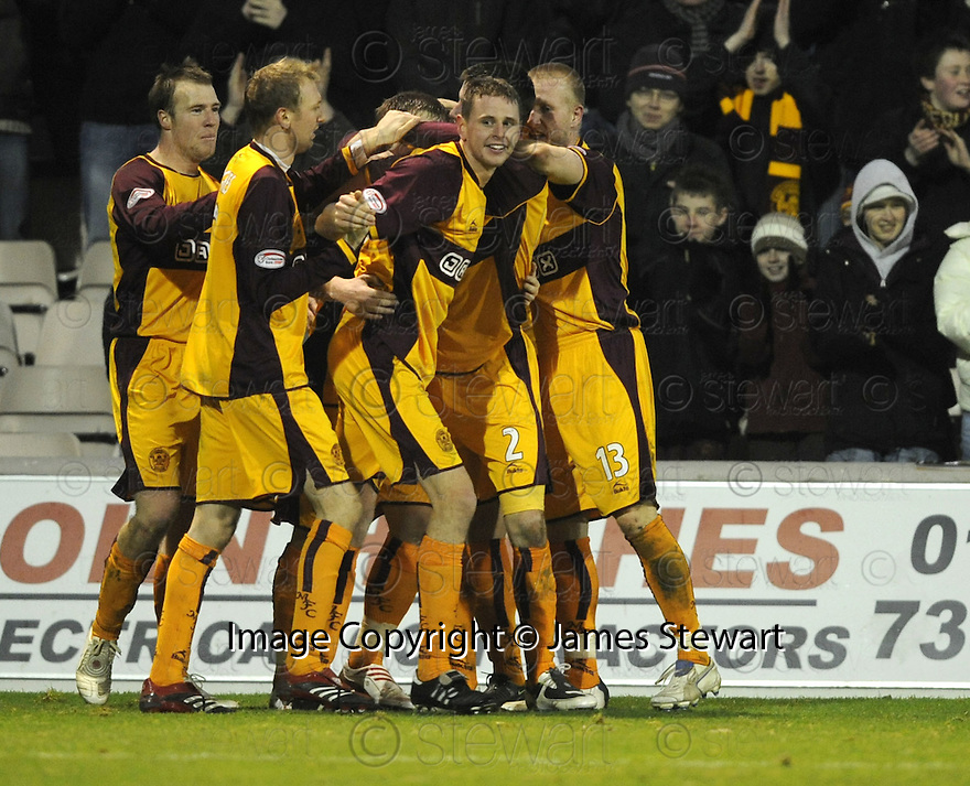 27/12/2008  Copyright Pic: James Stewart.File Name : sct_jspa16_motherwell_v_ICT.CHRIS PORTER IS CONGRATULATED AFTER HE SCORES HIS THIRD.James Stewart Photo Agency 19 Carronlea Drive, Falkirk. FK2 8DN      Vat Reg No. 607 6932 25.Studio      : +44 (0)1324 611191 .Mobile      : +44 (0)7721 416997.E-mail  :  jim@jspa.co.uk.If you require further information then contact Jim Stewart on any of the numbers above.........