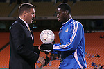 27 October 2007: Kansas City Technical Director Peter Vermes (l) presents Eddie Johnson with the team's Most Valuable Player award for the 2007 season. The Kansas City Wizards defeated Club Deportivo Chivas USA 1-0 in the first leg of their Major League Soccer Western Conference Semifinal playoff series at Arrowhead Stadium in Kansas City, Missouri.