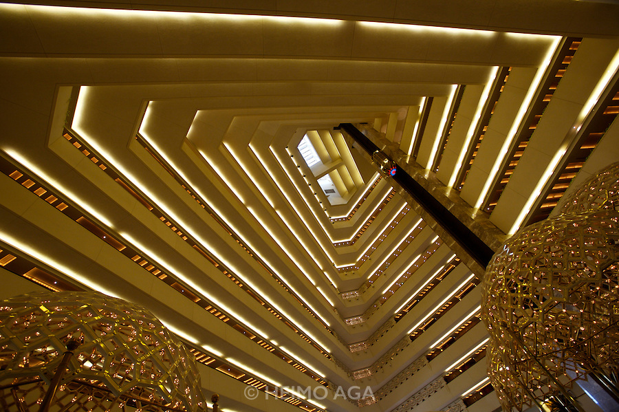 The landmark pyramid of Sheraton Doha hotel; the atrium.