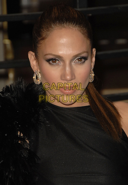 JENNIFER LOPEZ.The 2010 Vanity Fair Oscar Party held at The Sunset Tower Hotel in West Hollywood, California, USA..March 7th, 2010.oscars headshot portrait black silk satin feathers gold earrings  .CAP/RKE/DVS.©DVS/RockinExposures/Capital Pictures.