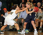 SPEARFISH, SD - DECEMBER 3, 2015 -- Taylor Molstad #4 of South Dakota Mines holds the ball away from Black Hills State defender Christine Thorn #34 during their college basketball game Saturday at the Donald E. Young Center in Spearfish, S.D. (Photo by Dick Carlson/Inertia)