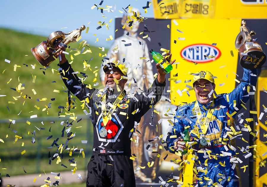 May 21, 2017; Topeka, KS, USA; Confetti falls as NHRA top fuel driver Antron Brown (left) and funny car driver Ron Capps celebrate after winning the Heartland Nationals at Heartland Park Topeka. Mandatory Credit: Mark J. Rebilas-USA TODAY Sports