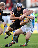 High Wycombe, England. Marco Wentzel of London Wasps tackles Paul Hodgson of Worcester Warriors during the Aviva Premiership match between London Wasps and Worcester Warriors at Adam Park on October 7, 2012 in High Wycombe, England.