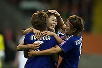 Homare Sawa (10) of Japan celebrates her goal with teammates Aya Miyama (8) and Nahomi Kawasumi (9) during the final of the FIFA Women's World Cup at FIFA Women's World Cup Stadium in Frankfurt Germany.  Japan won the FIFA Women's World Cup on penalty kicks after tying the United States, 2-2, in extra time.