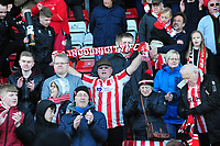 Lincoln City fans celebrate promotion<br /> <br /> Photographer Andrew Vaughan/CameraSport<br /> <br /> The EFL Sky Bet League Two - Lincoln City v Cheltenham Town - Saturday 13th April 2019 - Sincil Bank - Lincoln<br /> <br /> World Copyright &copy; 2019 CameraSport. All rights reserved. 43 Linden Ave. Countesthorpe. Leicester. England. LE8 5PG - Tel: +44 (0) 116 277 4147 - admin@camerasport.com - www.camerasport.com