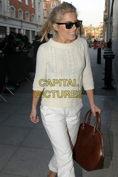 Mollie King .The Saturdays arriving at BBC Radio 1, London, England..4th March 2013.full length white sweater jumper top knitted cropped trousers rolled turned up brown leather jacket  sunglasses shades.CAP/IA.©Ian Allis/Capital Pictures.