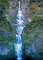 738600053 columbia river gorge national scenic area oregon winter cold freezes parts of mulnomah falls with the bridge shown between the two hills on a late fall day